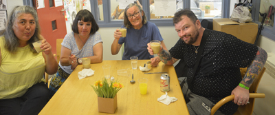 Service users enjoying banana and cinnamon pudding
